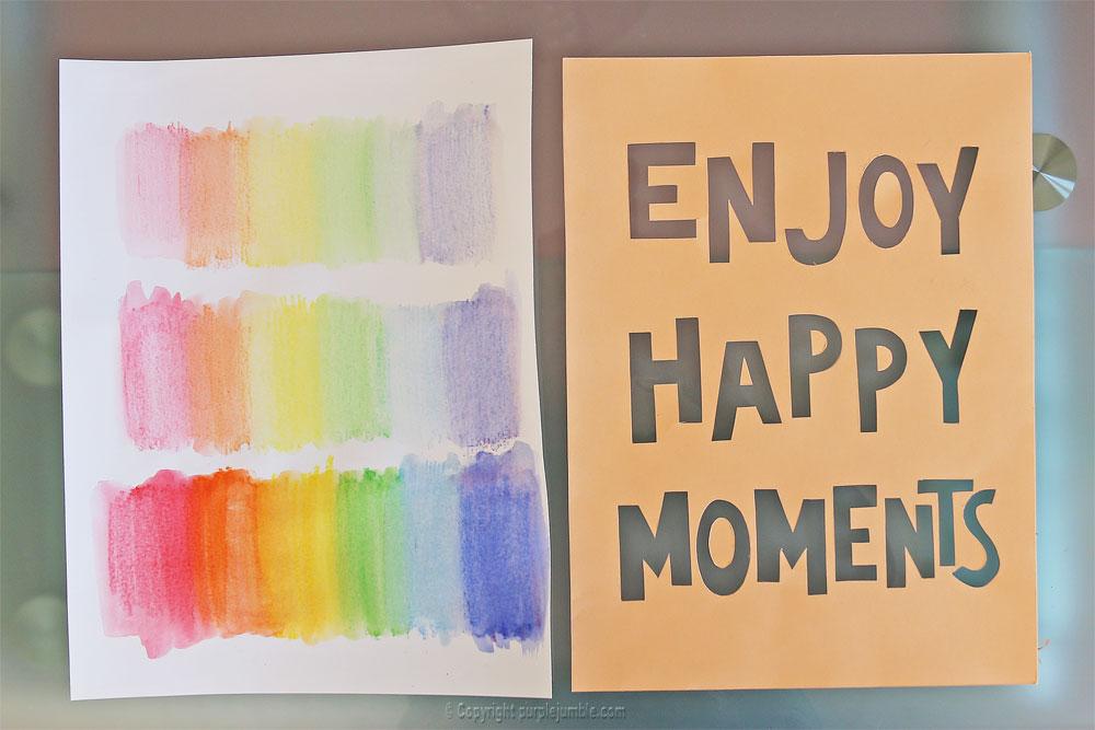 affiche enjoy happy moments lettres arc-en-ciel