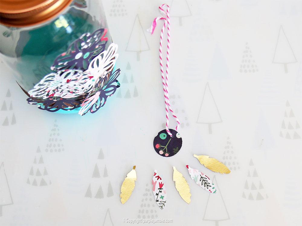 pot en verre décoré plumes